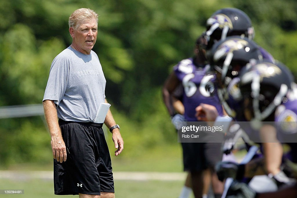Offensive coordinator Cam Cameron of the Baltimore Ravens watches work outs during training camp on July 29, 2011 in Owings Mills, Maryland.