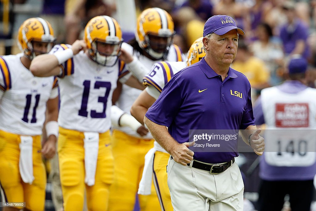 Offensive coordinator Cam Cameron of the LSU Tigers runs onto the field prior to a game against the Sam Houston State Bearkats at Tiger Stadium on September 6, 2014 in Baton Rouge, Louisiana. LSU won the game 56-0.