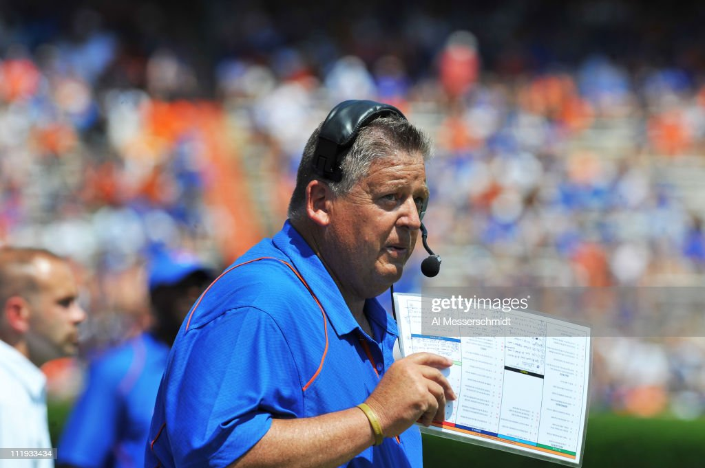 Offensive coordinator <a gi-track='captionPersonalityLinkClicked' href=/galleries/search?phrase=Charlie+Weis&family=editorial&specificpeople=631229 ng-click='$event.stopPropagation()'>Charlie Weis</a> of the Florida Gators directs play during the Orange and Blue spring football game April 9, 2010 Ben Hill Griffin Stadium in Gainesville, Florida.