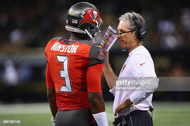 Offensive coordinator Dirk Koetter and Jameis Winston of the Tampa Bay Buccaneers at MercedesBenz Superdome on September 20 2015 in New Orleans...