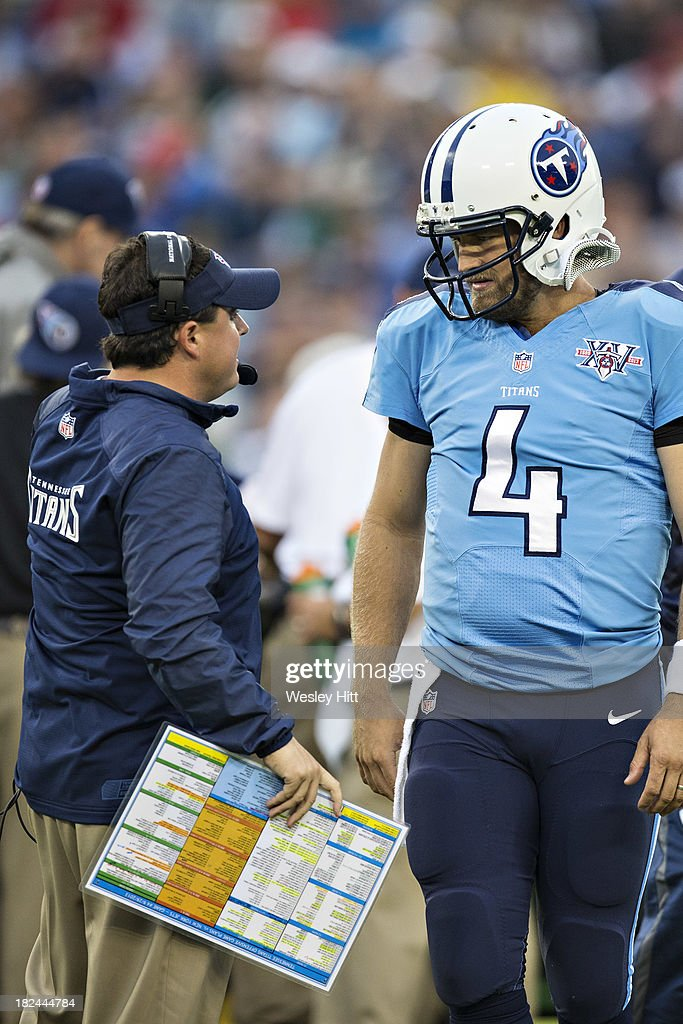 Offensive Coordinator <a gi-track='captionPersonalityLinkClicked' href=/galleries/search?phrase=Dowell+Loggains&family=editorial&specificpeople=6139895 ng-click='$event.stopPropagation()'>Dowell Loggains</a> and <a gi-track='captionPersonalityLinkClicked' href=/galleries/search?phrase=Ryan+Fitzpatrick&family=editorial&specificpeople=622098 ng-click='$event.stopPropagation()'>Ryan Fitzpatrick</a> #4 of the Tennessee Titans talk on the field during a game against the New York Jets at LP Field on September 29, 2013 in Nashville, Tennessee. The Titans defeated the Jets 38-13.