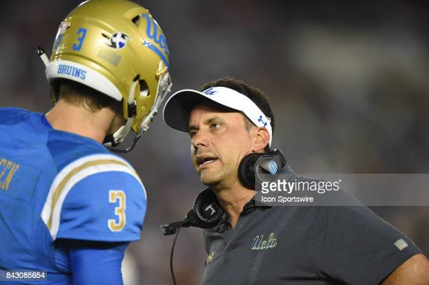 UCLA offensive coordinator Jedd Fisch talks with UCLA Josh Rosen during a college football game between the Texas AM Aggies and the UCLA Bruins on...