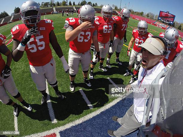 Offensive Coordinator Jeff Behrman speaks to the Stony Brook Offense during their Spring Football Game at Kenneth P LaValle Stadium on April 26 2014...