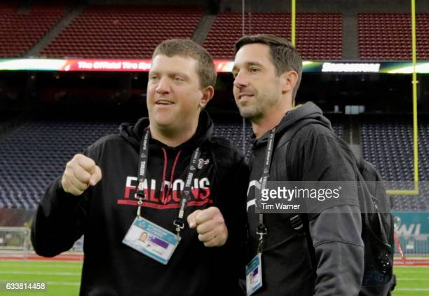 Offensive Coordinator Kyle Shanahan talks with a staff member during the Super Bowl LI team walk through at NRG Stadium on February 4 2017 in Houston...