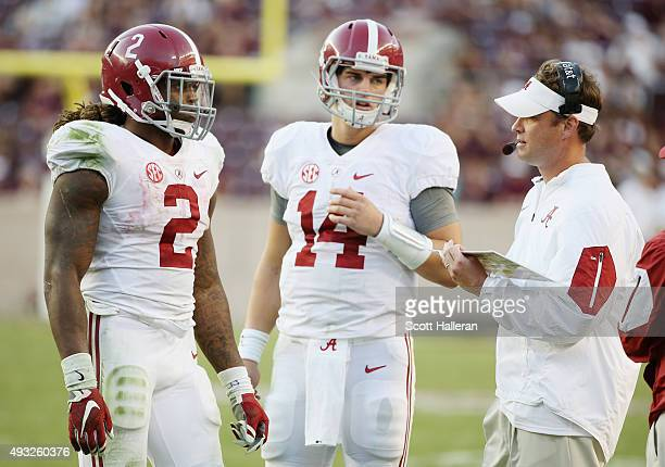 Offensive coordinator Lane Kiffin of the Alabama Crimson Tide chats with his quarterback Jake Coker and Derrick Henry on the sideline during the...