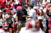 Offensive coordinator Lane Kiffin of the Alabama Crimson Tide speaks with former player AJ McCarron prior to the University of Alabama ADay spring...