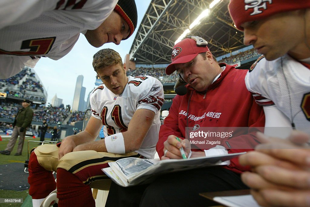 Offensive coordinator Mike McCarthy reviews plays with quarterbacks Ken Dorsey Alex Smith and Cody Pickett of the San Francisco 49ers during the game...