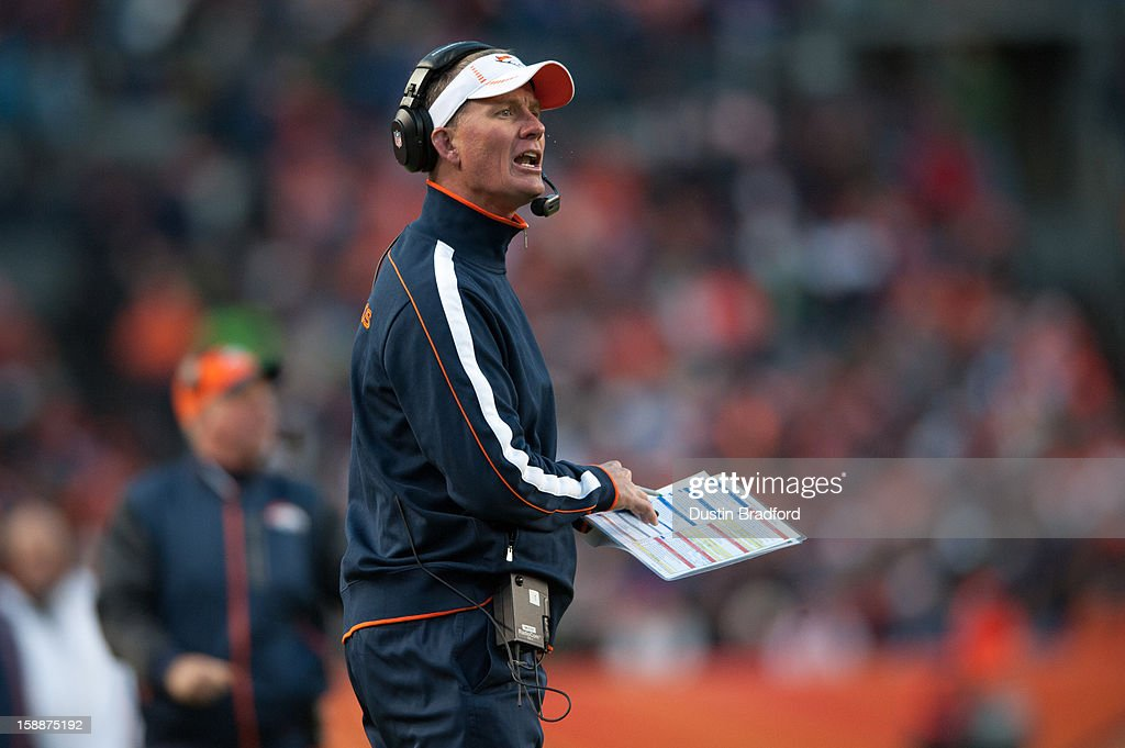 Offensive coordinator Mike McCoy yells to players during a game against the Kansas City Chiefs at Sports Authority Field at Mile High on December 30, 2012 in Denver, Colorado. The Broncos defeated the Chiefs 38-3.
