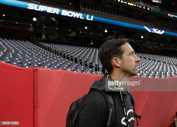 Offensive coordinator of the Atlanta Falcons walks out to the field during the Super Bowl LI team walk through at NRG Stadium on February 4 2017 in...