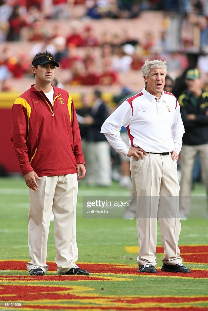 Offensive Coordinator Steve Sarkisian and head coach Pete Carroll of the USC Trojans look on before the game against the Oregon Ducks on October 4...