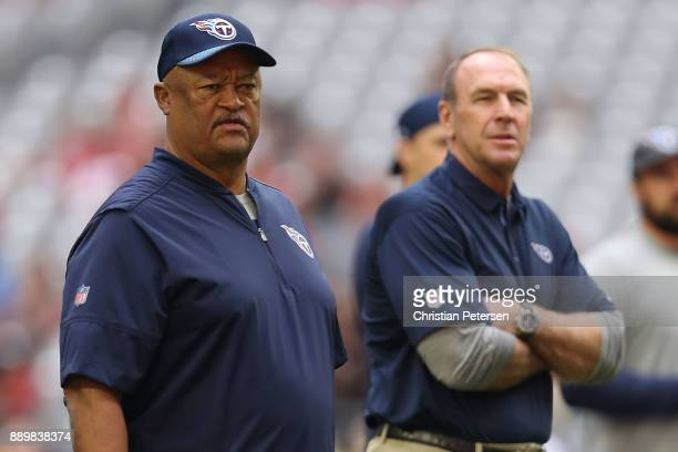 Offensive coordinator Terry Robiskie and head coach Mike Mularkey of the Tennessee Titans look on prior to the NFL game against the Arizona Cardinals...