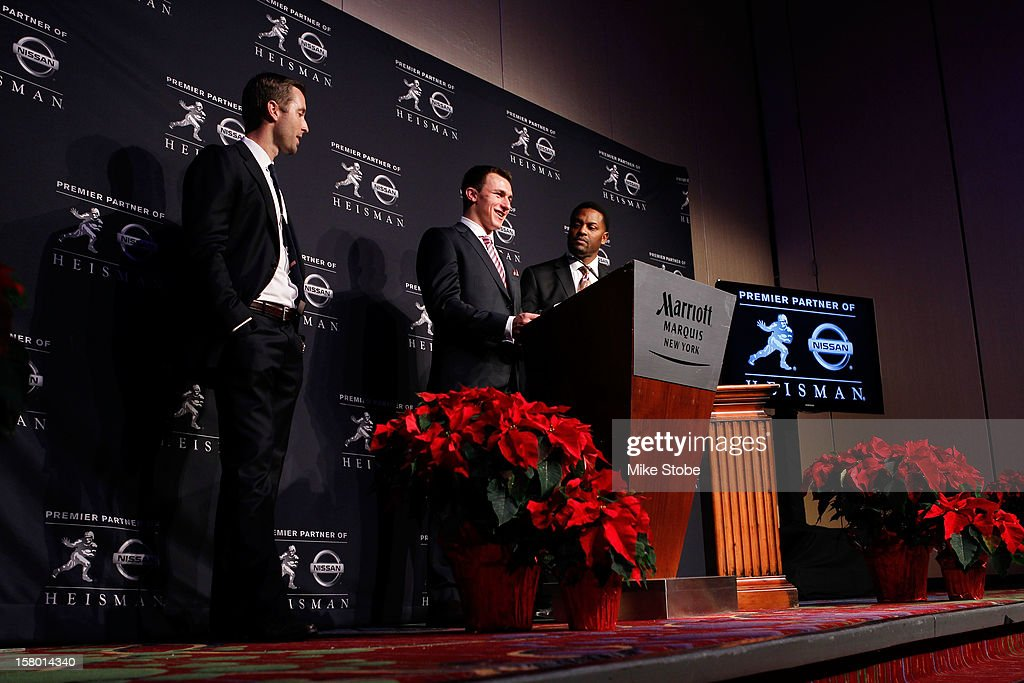 Offensive Coordinator/Quarterbacks Kliff Kingsbury quarterback Johnny Manziel of the Texas A&M University Aggies and head coach Kevin Sumlin pose after being named the 78th Heisman Memorial Trophy Award winner at a press conference at the Marriott Marquis on December 8, 2012 in New York City.