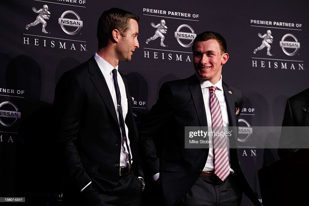 Offensive Coordinator/Quarterbacks Kliff Kingsbury quarterback <a gi-track='captionPersonalityLinkClicked' href=/galleries/search?phrase=Johnny+Manziel&family=editorial&specificpeople=9703372 ng-click='$event.stopPropagation()'>Johnny Manziel</a> of the Texas A&M University Aggies pose after being named the 78th Heisman Memorial Trophy Award winner at a press conference at the Marriott Marquis on December 8, 2012 in New York City.