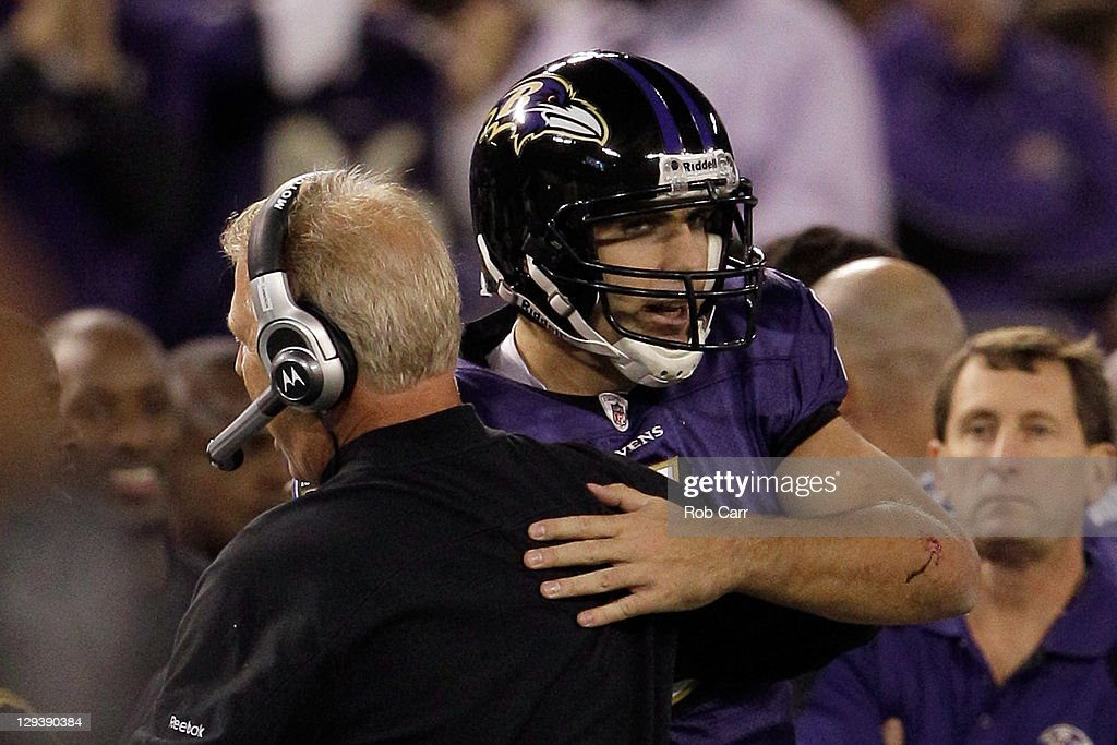 Offensive cordinator Cam Camerson hugs quarterback <a gi-track='captionPersonalityLinkClicked' href=/galleries/search?phrase=Joe+Flacco&family=editorial&specificpeople=4645672 ng-click='$event.stopPropagation()'>Joe Flacco</a> #5 of the Baltimore Ravens during the closing moments of the Ravens 29-14 win over the Houston Texans at M&T Bank Stadium on October 16, 2011 in Baltimore, Maryland.