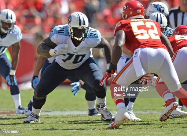 Offensive guard Chance Warmack of the Tennessee Titans gets set to block linebacker JamesMichael Johnson of the Kansas City Chiefs during the first...