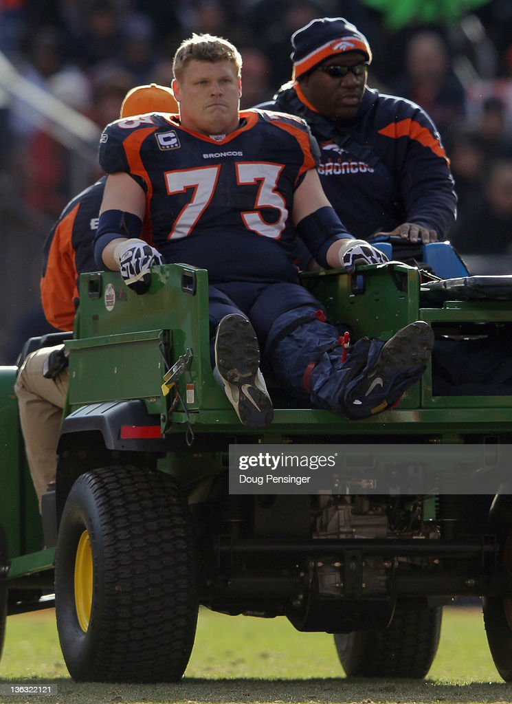 Offensive guard <a gi-track='captionPersonalityLinkClicked' href=/galleries/search?phrase=Chris+Kuper&family=editorial&specificpeople=469695 ng-click='$event.stopPropagation()'>Chris Kuper</a> #73 of the Denver Broncos is taken off the field after suffering a leg injury in the first quarter against the Kansas City Chiefs at Sports Authority Field at Mile High on January 1, 2012 in Denver, Colorado.