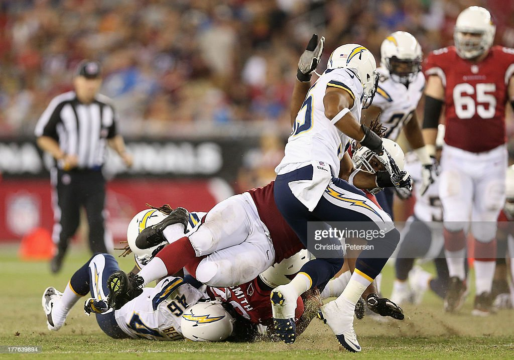 Offensive guard Jonathan Cooper #61 of the Arizona Cardinals falls to the ground as he broke his left fibula while attempting a tackle against the San Diego Chargers during the preseason NFL game at the University of Phoenix Stadium on August 24, 2013 in Glendale, Arizona.