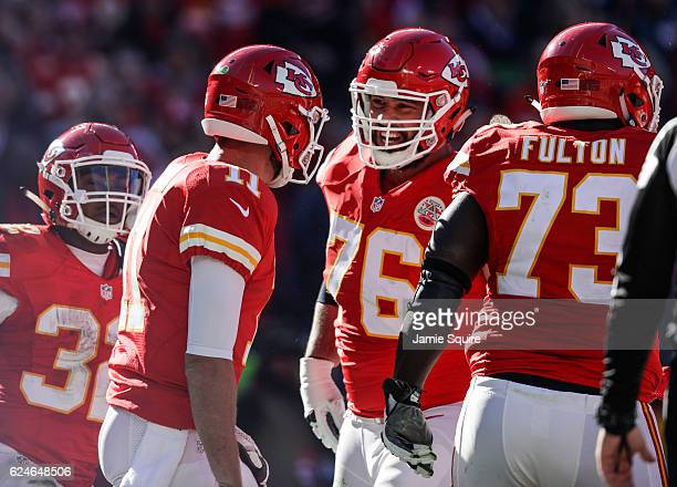 Offensive guard Laurent DuvernayTardif of the Kansas City Chiefs celebrates with Alex Smith after Smith slid in to the end zone scoring the games...