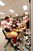 Offensive Line Coach Mike Solari of the San Francisco 49ers talks with Joe Staley Joe Looney Daniel Kilgore and Alex Boone in the locker room prior...