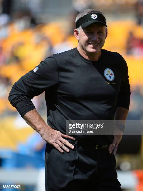 Offensive line coach/Hall of fame offensive lineman Mike Munchak of the Pittsburgh Steelers stands on the field prior to a preseason game on August...