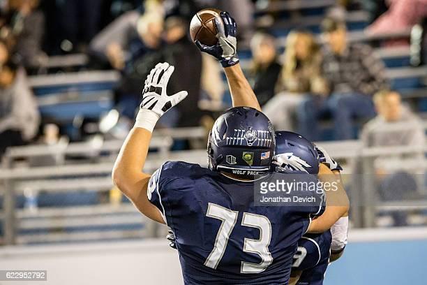 Offensive lineman Austin Corbett of Nevada celebrates after teammate wide receiver Wyatt Demps scored a touchdown over San Diego at Mackay Stadium on...