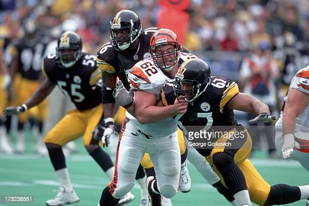 Offensive lineman Brock Gutierrez of the Cincinnati Bengals blocks defensive lineman Kimo von Oelhoffen of the Pittsburgh Steelers as linebacker Joey...