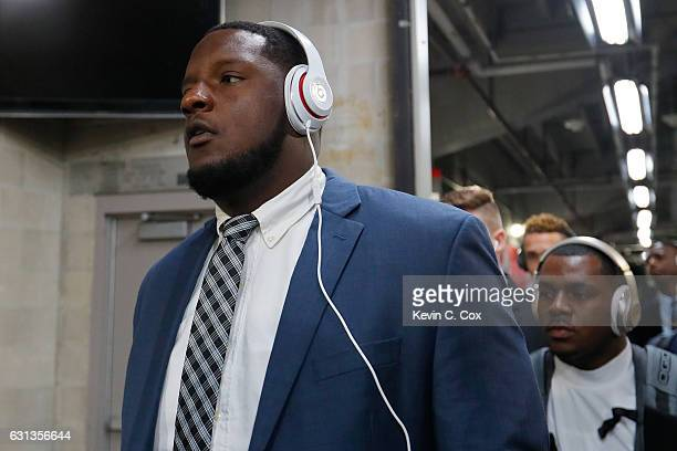 Offensive lineman Cam Robinson of the Alabama Crimson Tide arrives before taking on the Clemson Tigers in the 2017 College Football Playoff National...