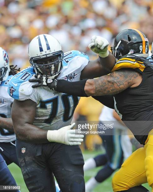 Offensive lineman Chance Warmack of the Tennessee Titans blocks defensive lineman Ziggy Hood of the Pittsburgh Steelers during a game at Heinz Field...