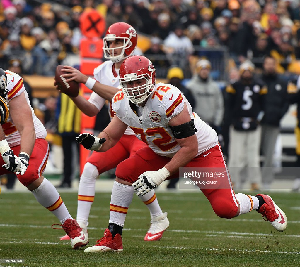 Offensive lineman <a gi-track='captionPersonalityLinkClicked' href=/galleries/search?phrase=Eric+Fisher+-+American+Football+Player&family=editorial&specificpeople=10866831 ng-click='$event.stopPropagation()'>Eric Fisher</a> #72 of the Kansas City Chiefs blocks as quarterback <a gi-track='captionPersonalityLinkClicked' href=/galleries/search?phrase=Alex+Smith+-+American+Football+Quarterback&family=editorial&specificpeople=4584854 ng-click='$event.stopPropagation()'>Alex Smith</a> #11 drops back to pass during a game against the Pittsburgh Steelers at Heinz Field on December 21, 2014 in Pittsburgh, Pennsylvania. The Steelers defeated the Chiefs 20-12.