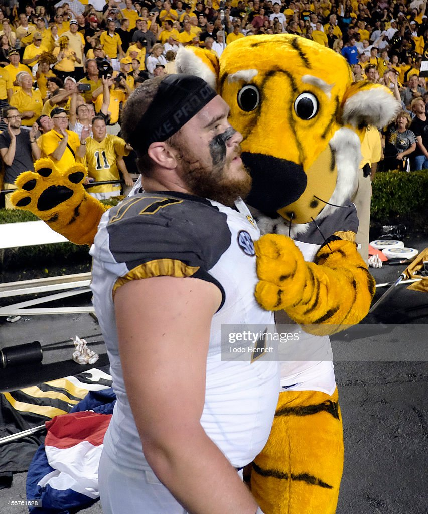 Offensive lineman <a gi-track='captionPersonalityLinkClicked' href=/galleries/search?phrase=Evan+Boehm&family=editorial&specificpeople=9839229 ng-click='$event.stopPropagation()'>Evan Boehm</a> #77 of the Missouri Tigers celebrates with mascot Truman after the game against the South Carolina Gamecocks on September 27, 2014 at Williams-Brice Stadium in Columbia, South Carolina. Missouri won 21-20.