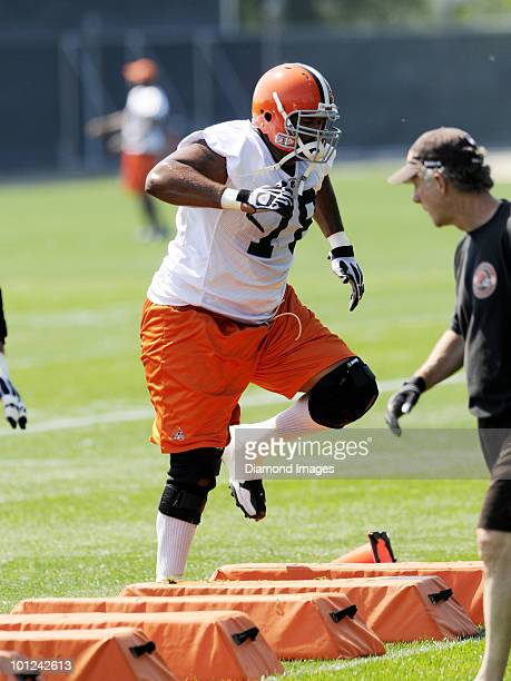 Offensive lineman John St Clair of the Cleveland Browns performs an agility drill during the team's organized team activity on May 27 2010 at the...
