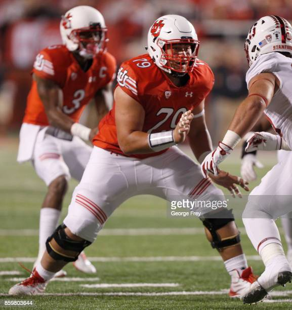 Offensive lineman Jordan Agasiva of the Utah Utes looks to block during the first half of an college football game against the Stanford Cardinal on...
