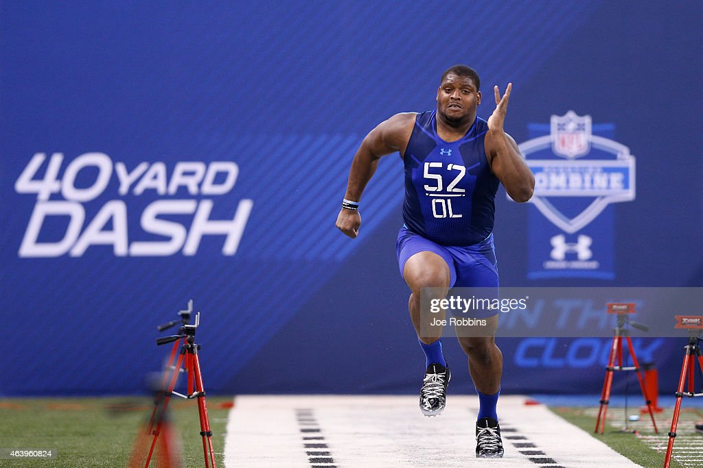 Offensive lineman Laken Tomlinson of Duke runs the 40yard dash during the 2015 NFL Scouting Combine at Lucas Oil Stadium on February 20 2015 in...