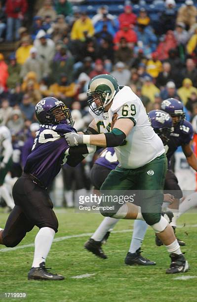 Offensive lineman Morgan Pears of Colorado State University puts a hold on Linebacker Martin Patterson of Texas Christian University during the AXA...