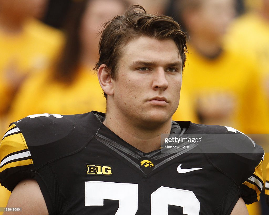 Offensive lineman Nolan Macmillan #76 of the Iowa Hawkeyes lines up on the field before their match-up against the Michigan State Spartans on October 5, 2013 at Kinnick Stadium in Iowa City, Iowa. Michigan State won 26-14.
