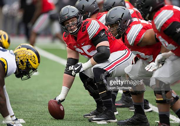 Offensive lineman Pat Elflein of the Ohio State Buckeyes makes sure the line is ready during an NCAA football game between the Michigan Wolverines...