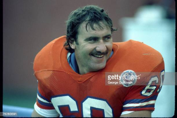 Offensive lineman Paul Howard of the Denver Broncos smiles while on the sideline during a game against the Buffalo Bills at Rich Stadium on October...