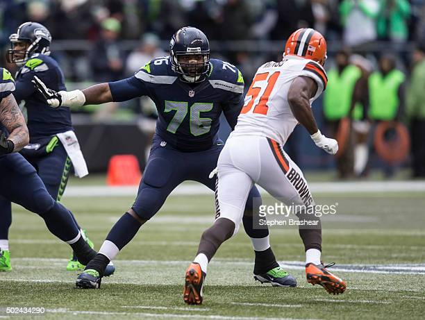 Offensive lineman Russell Okung pass blocks during the first half of a football game against the Cleveland Browns at CenturyLink Field on December 20...