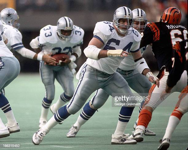 Offensive lineman Tom Rafferty of the Dallas Cowboys blocks for running back Tony Dorsett during a game against the Cincinnati Bengals at Riverfront...