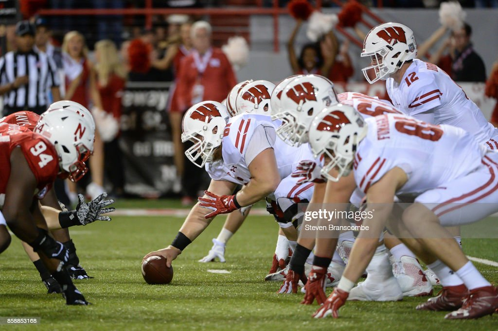 Offensive lineman Tyler Biadasz #61 of the Wisconsin Badgers snaps the ball to quarterback Alex Hornibrook #12 against the Nebraska Cornhuskers at Memorial Stadium on October 7, 2017 in Lincoln, Nebraska.