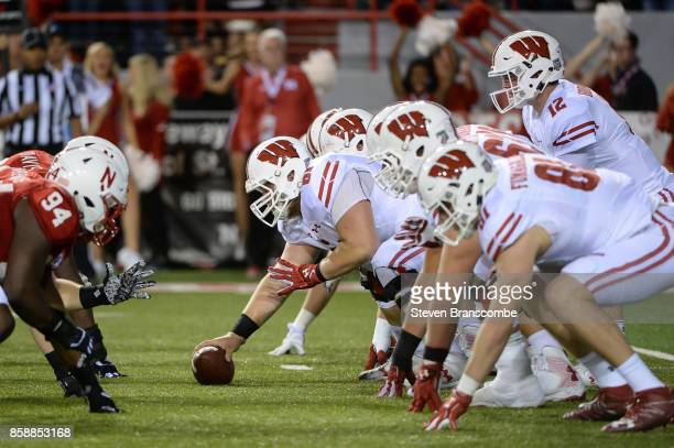 Offensive lineman Tyler Biadasz of the Wisconsin Badgers snaps the ball to quarterback Alex Hornibrook against the Nebraska Cornhuskers at Memorial...