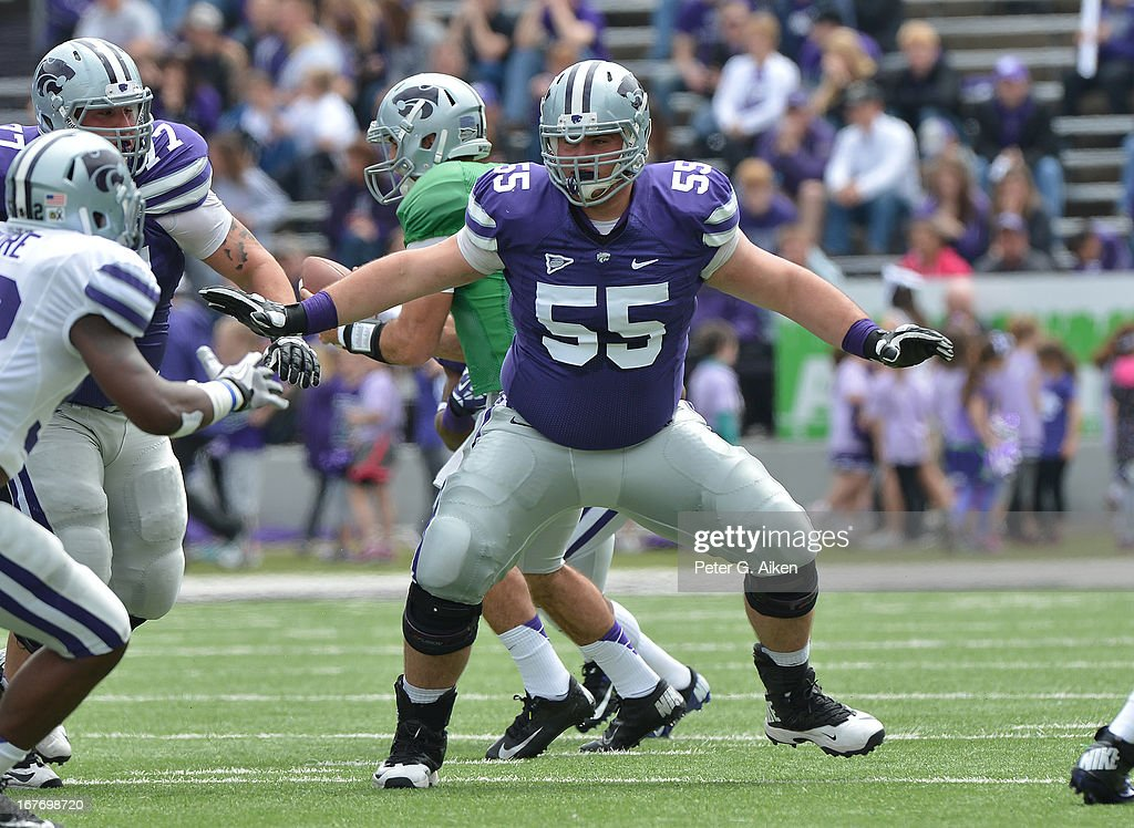 Offensive linemen Cody Whitehair #55 of the Kansas State Wildcats gets set on offense during the Purple and White Spring Game on April 27, 2013 at Bill Snyder Family Stadium in Manhattan, Kansas.