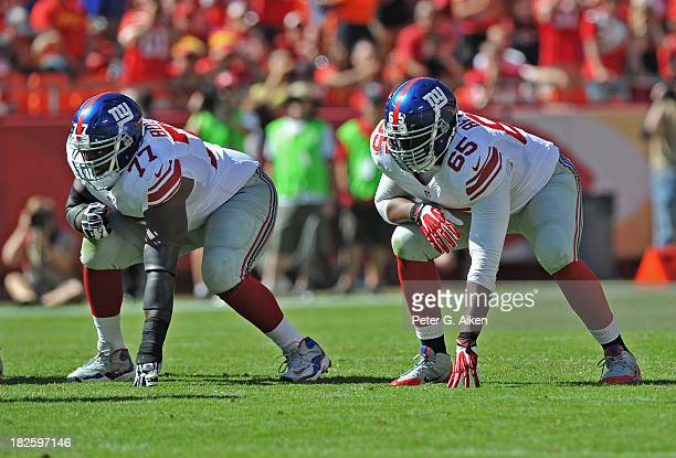 Offensive linemen Kevin Boothe and Will Beatty of the New York Giants gets set on the line against the Kansas City Chiefs during the first half on...