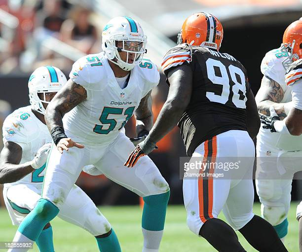 Offensive linemen Mike Pouncey of the Miami Dolphins sets up to block defensive linemen Phil Taylor of the Cleveland Browns during a game against the...