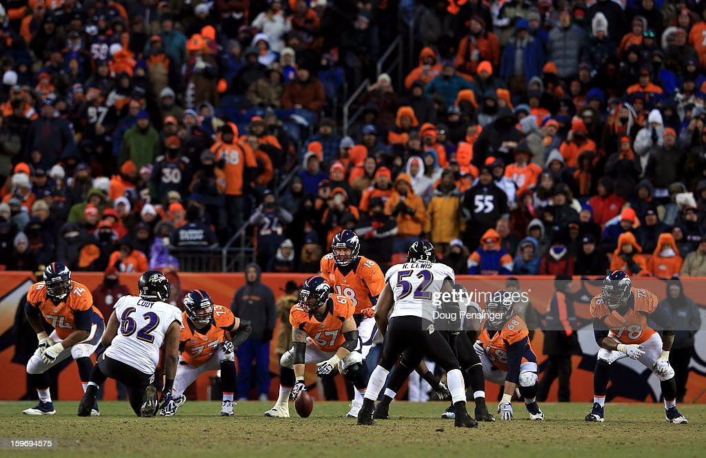 Offensive linemen Orlando Franklin #74, Chris Kuper #73, Dan Koppen #67, Zane Beadles #68 and Ryan Clady #78 of the Denver Broncos get set to block as quarterback Peyton Manning #18 calls out signals at the line of scrimmage against Ray Lewis #52 of the Baltimore Ravens during the AFC Divisional Playoff Game at Sports Authority Field at Mile High on January 12, 2013 in Denver, Colorado.