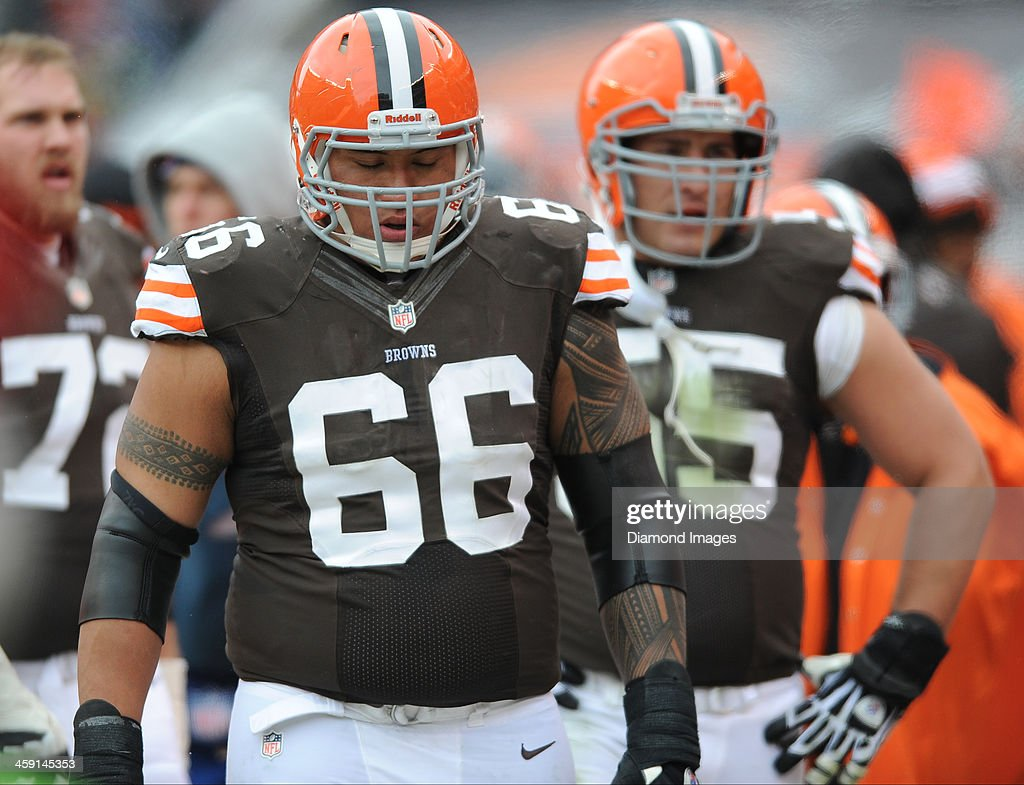 Offensive linemen <a gi-track='captionPersonalityLinkClicked' href=/galleries/search?phrase=Shawn+Lauvao&family=editorial&specificpeople=4629010 ng-click='$event.stopPropagation()'>Shawn Lauvao</a> #66 of the Cleveland Browns walks on the sideline after a offensive series during a game against the Chicago Bears at FirstEnergy Stadium in Cleveland, Ohio. The Bears won 38-31.