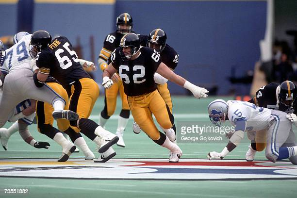 Offensive linemen Tunch Ilkin and Ray Pinney of the Pittsburgh Steelers block for running back Earnest Jackson during a game against the Detroit...