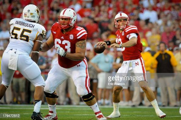 Offensive linesman Andrew Rodriguez of the Nebraska Cornhuskers blocks as teammate quarterback Taylor Martinez during their game at Memorial Stadium...