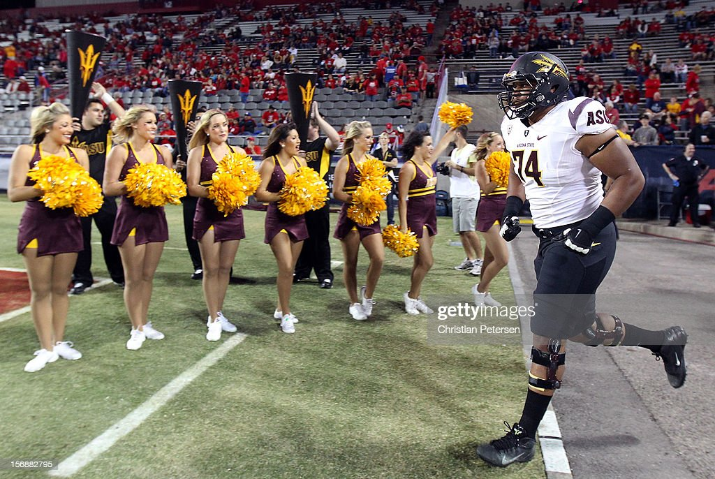 Offensive linesman Jamil Douglas #74 of the Arizona State Sun Devils runs out onto the field before the college football game against the Arizona Wildcats at Arizona Stadium on November 23, 2012 in Tucson, Arizona.