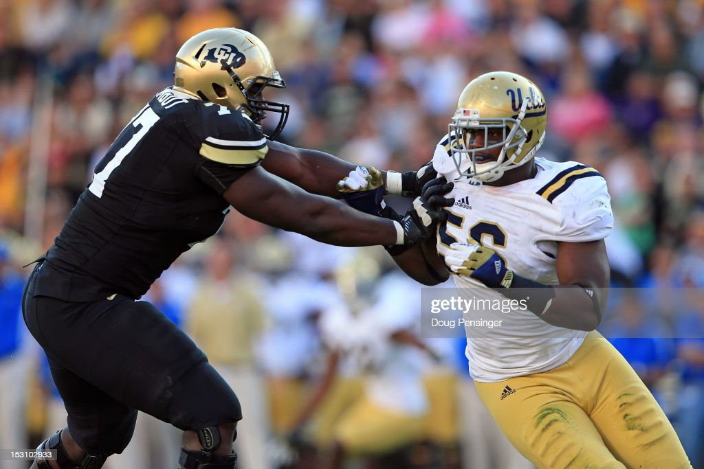 Offensive linesman Stephane Nembot #77 of the Colorado Buffaloes blocks defensive end Datone Jones #56 of the UCLA Bruins at Folsom Field on September 29, 2012 in Boulder, Colorado. UCLA defeated Colorado 42-14.